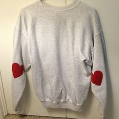 Grey/ Red Heart Sweatshirt Only worn once! Great condition, no flaws. The hearts are on the elbows, the first picture is of the back of the sweatshirt. Sweaters