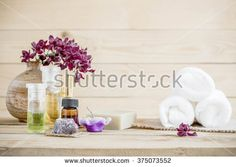 spa massage setting, orchid product, oil on wooden background.