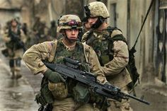 U.S. Army soldiers from the 1st Battalion, 24 Infantry Regiment search for insurgents in Mosul, Iraq, Monday, Nov. 22, 2004. U.S. and Iraqi forces in Mosul have been working put down an uprising launched by guerrillas who seized police stations and other sites. (AP Photo/Jim MacMillan)