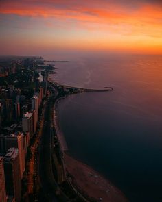 The Colorful Sunrise at 360 Chicago Observation Deck in the John Hancock Building. Best place to see endless aerial views of Chicago, the Beaches, and of Lake Michigan.