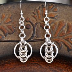 "925 sterling Silver chainmaille earrings. ""Circles"". $30.00, via Etsy."
