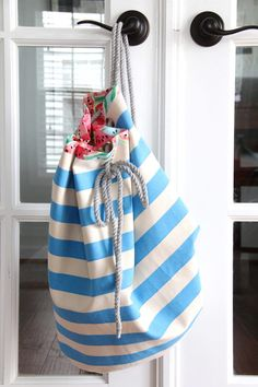 A sewing tutorial for how to make a drawstring bag, with free drawstring bag sewing pattern; a great summer craft!