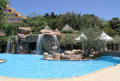 Beautiful pool with a waterfall at the Cascades Hotel Sun City in South Africa Sun City South Africa, Sun City Resort, Places To Travel, Places To See, Places Around The World, Around The Worlds, Adventure Style, Hotel Pool, Holiday Resort