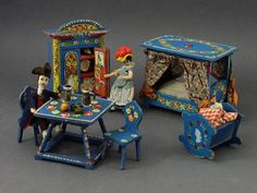 A beautiful rare German bauernmalerei Bavarian furniture set from dollhouse manufacturer Dora Kuhn. Original condition. Hand-painted. Ca.1920. Likely a 1:12 scale. The initials on the dresser mean: JHS-Jesus His Savior All the accessories inside and the paintings on the doors are originally with the dresser. Collectible toy not suitable for small children. The set includes 10 pieces: - 1 dresser (H: 15 x W: 11 x D: 4,5 cm / H: 5.9 x W: 4.33 x D: 1.77) - 1 canopy bed (H: 11,7 x W: 14,1 ...