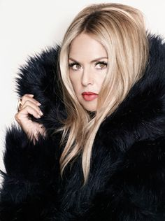 rachel zoe...she can be a bit over the top - but I have to admit that I love watching her tv show.