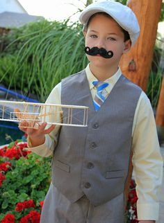 Orville Wright costume. Bought kids dress clothes set on sale at JCP and assembled model airplane bought online.