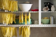 In our old house, we had inserted into the frames of our cabinets for drying our handmade pasta. Time to make some for this house.  DIY: Instant Pasta Drying Rack by Sarah Lonsdale