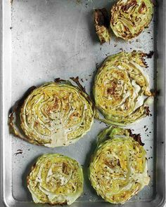 Roasted Cabbage Wedges INGREDIENTS  1 tablespoon plus 2 more tablespoons extra-virgin olive oil 1 medium head green cabbage, cut into 1-inch-thick rounds Coarse salt and ground pepper 1 teaspoon caraway or fennel seeds DIRECTIONS  Preheat oven to 400 degrees. Brush a rimmed baking sheet with 1 tablespoon coconut oil.