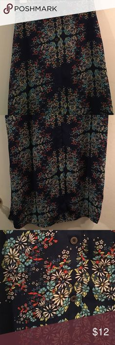 Floral Maxi Skirt Blue floral maxi skirt, with buttons down the front and slits on the sides and front. Made with great material and in perfect condition! Socialite Skirts Maxi