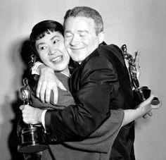 "Miyoshi Umeki and Red Buttons after winning Academy Awards for ""Sayonara."" She was the first Asian actress to win an Oscar."