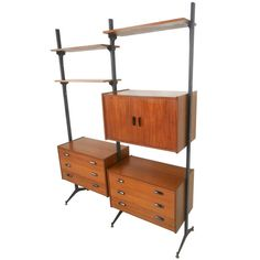 Mid-Century Modern Italian Teak Freestanding Wall Unit | See more antique and modern Shelves and Wall Cabinets at https://www.1stdibs.com/furniture/wall-decorations/shelves-wall-cabinets