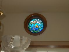 Hand Made Stained Glass Porthole Window - Residential by Cathedral Stained Glass Studios, Inc. | CustomMade.com
