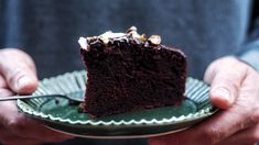 Close up of a slice of chocolate olive oil cake on a plate being held by hands, a delicious dessert recipe. Chocolate Olive Oil Cake, Chocolate Glaze, Chocolate Food, Chocolate Cakes, Chocolate Hazelnut, Cake Recipes, Dessert Recipes, Desserts, Meat Recipes