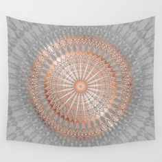 Trendy mandala design in rose gold on light gray.