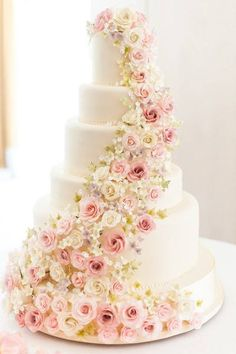 I love the number of flowers on this cake, definitely not pink, maybe teal or darker purple ombre up to teal and white would be very pretty