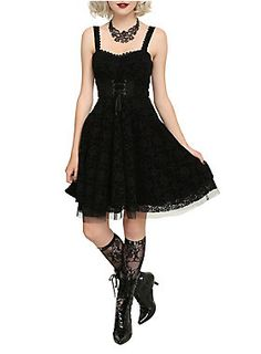 """<p><span id=""""webDesc"""">Black dress from the Hot Topic exclusive <i>The Nightmare Before Christmas</i> collection with a flocked Jack Skellington filigree pattern, lace-up detailing and tulle underlay. Back zipper closure.</span></p>  <ul> <li><span id=""""bullet0"""">82% rayon; 16% nylon; 2% spandex</span><span id=""""bullet0Span""""></span></li> <li><span id=""""bullet1"""">Wash cold; dry low </span></li> <li><span id=""""bullet2"""">Imported</span></li> </ul>"""