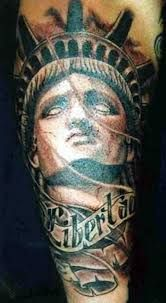 What does statue of liberty tattoo mean? We have statue of liberty tattoo ideas, designs, symbolism and we explain the meaning behind the tattoo. Wrist Tattoos, Sleeve Tattoos, Tattos, Statue Of Liberty Tattoo, Off The Map Tattoo, American Flag Wallpaper, Patriotic Tattoos, Rose Tattoos For Women, Outline Art