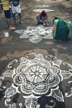 Kolam is a rangoli traditionally composed of geometric lines and shapes, drawn around a grid pattern of dots. It is drawn by south Indian women with rice or chalk powder in front of their homes.