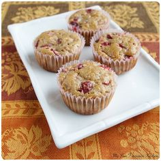 A recipe for moist, lightly spiced muffins made with cranberries and walnuts.