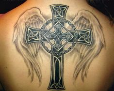 http://slodive.com/wp-content/uploads/2012/05/cross-tattoo-on-back/celtic-cross-tattoo-with-wings.jpg