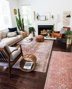 Layered and cozy eclectic living space. Boho, vintage and mid century modern accents. #livingroom #midcenturymodern #livingroomideas