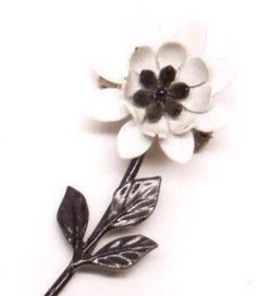 A personal favorite from my Etsy shop https://www.etsy.com/listing/286948169/vintage-black-white-painted-enamel