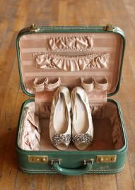 Cute cream flats in a vintage blue suitcase