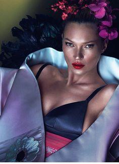 Kate Moss wears Prada satin stole and bra. Philip Treacy headpiece; Kimono House, New York obi.
