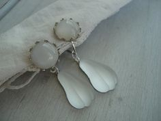 This is a beautiful pair of stud pierced earrings made with vintage white moonstone glass cabochons in silver crown settings, with vintage new old stock frosted white glass jewel drops.  Luminescent; appears lit from within: lovely moon glow look.  Silver screw backs.  Handmade with love and reiki healing energy.  This listing is for one pair of earrings.   Measurements:  Length: A tiny bit over 1.5 inches.  Width: About .5 inch.   * * *  If you enjoy the colors, feel and essence of jewelry…