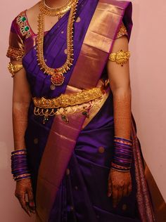 Purple and Gold Silk Saree with Matching Pink Stonework Blouse and Gold Jewelry