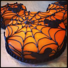 Make a Halloween Mickey Mouse cake, the pipe on icing in the shape of a spider web.