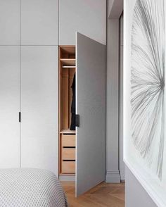 Classical, modern & minimal collide in this London apartment designed by Interior-iD ~ loving the timber cabinetry interior & herringbone to compliment it ✨