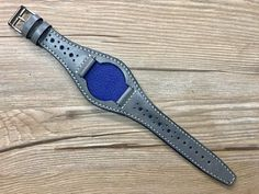 Leather Cuffs, Grey Leather, Leather Wallet, Leather Watches, Luxury Brand Names, Brand Name Watches, Grey Watch, Watch Model, Leather Bags Handmade
