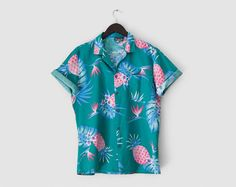 Vintage Hawaiian shirt in an amazing print of pineapples and bird of paradise flowers on an aqua green background