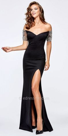Stunning rhinestone embellished sleeves, an off the shoulder neckline and a sultry thigh high slit make this Andi Evening Dress by Tarik Ediz an obvious choice for your next grand event. #edressme