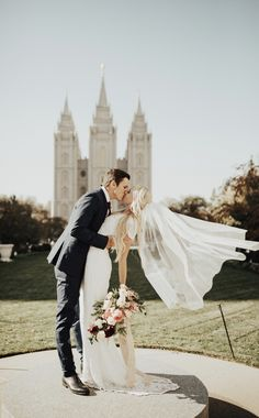 Gorgeous wedding photo of the bride and groom. I love photos of the bride's veil blowing in the wind. Perfection. Wedding photography | bride and groom | wedding kiss | outdoor wedding