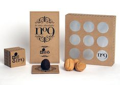 """""""Here's Thomas Jonkajtys' work in my packaging class. First, a mold was designed in a nut shape. Le package is designed out of laminated layers of corrugated board. A break through metallic sheet protects the nine chocolates. The name of the products is a French rebus where the roman number IX create the word NUT (NOIX)."""""""
