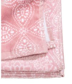 Light pink. Cotton bath towel with a printed pattern on velour at front and terry at back. Hanger loop on one short side.