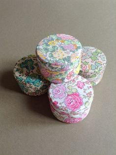 Cover small round boxes with Liberty of London fabrics. Brilliant.