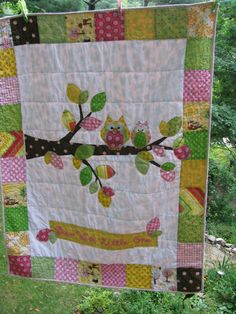 A custom owl quilt I designed and made featuring several of Riley Blake's Hoos in the Forest line among others...