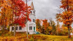 The picturesque St. John's Church can be found on Route 2 between Lancaster and Gorham, NH, on the corner of Black Velvet Road. There is also another small church nearby and a stone tower right near the road -- perfect for photo ops.