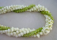Pikake (white) and Pakalana (green) flower lei are highly prized in Hawaii. Flower Lei, Flower Garlands, Flower Decorations, Hawaiian Flowers, Tropical Flowers, Hawaiian Leis, Floral Wedding, Wedding Flowers, Sampaguita