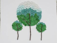 We Three Trees Made of Sea Glass and sticks! Comes in a wooden black frame with glass and is ready to hang! Frame measures about 13x9 and is matted to 7.5x5.5 Thanks for looking!:)