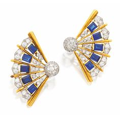 PAIR OF SAPPHIRE AND DIAMOND EARCLIPS, CIRCA 1940.  Designed as fans, set with 10 emerald-cut sapphires and 72 old European-cut and single-cut diamonds, mounted in gold and platinum.