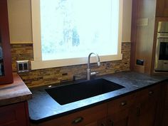 Soapstone countertops with single basin Blanco Silgranit sink.