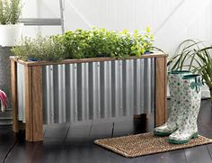 This garden planter box can easily be altered to fit various shapes and sizes, like squares or shorter rectangles to fit your space. In this example they used teak lumber, which drastically increased the cost, but you can easily work with salvage or a less expensive wood option.