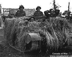 Caen - Carpiquet - Canadian soldiers with a member of the Luftwaffe taken prisoner. July 7, 1944.