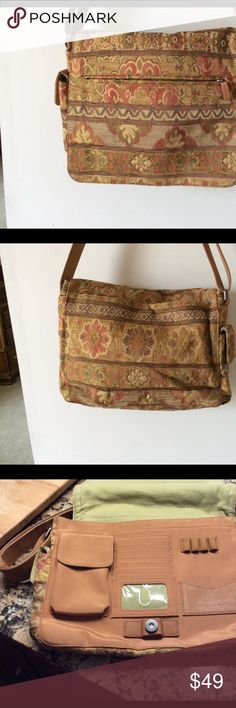 Beautiful Fossil brocade messenger bag. What a great travel bag, briefcase or laptop bag.   EUC.   Front has zip pocket on flap, back has deep pocket with magnetic closer.  Under flap, there is pouch for glasses, tons of card slots, pen holders.  Nice sized outside side pouch for cell phone.  Inside has zip pocket and slot large enough for file folders.  022210 Fossil Bags Laptop Bags