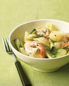 Shrimp Pasta Salad with Cucumber and Dill | Martha Stewart Living - The pasta water does double-duty here, boiling the noodles and then cooking the shrimp before both are tossed with cucumber, dill, and a lemony vinaigrette.
