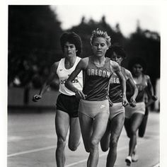 Black and white photo of four women runners, three of them representing the University of Oregon, in a race held in 1983. The Duck runners are Kathy Hayes (in front), Lisa Martin (in 3rd) and an unidentified runner in 4th place. The non-Duck runner is Julie Brown (running 2nd). ©University of Oregon Libraries - Special Collections and University Archives